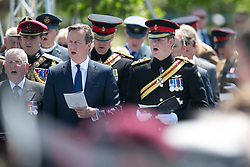 © Licensed to London News Pictures. 11/06/2015. National Memorial Arboretum, Alrewas, Staffordshire, UK. The service to mark the Rededication of the Bastion Memorial. The memorial was begun in Helmand Province in 2006, deconstructed in 2014 and now replicated at the National Memorial Arboretum in Staffordshire. Around two thousand people took part in the service including HRH Prince Harry, the Prime Minister David Cameron and senior members of the Armed Forces. Pictured, Prime Minister DAVID CAMERON AND HRH PRINCE HARRY. Photo credit : Dave Warren/LNP