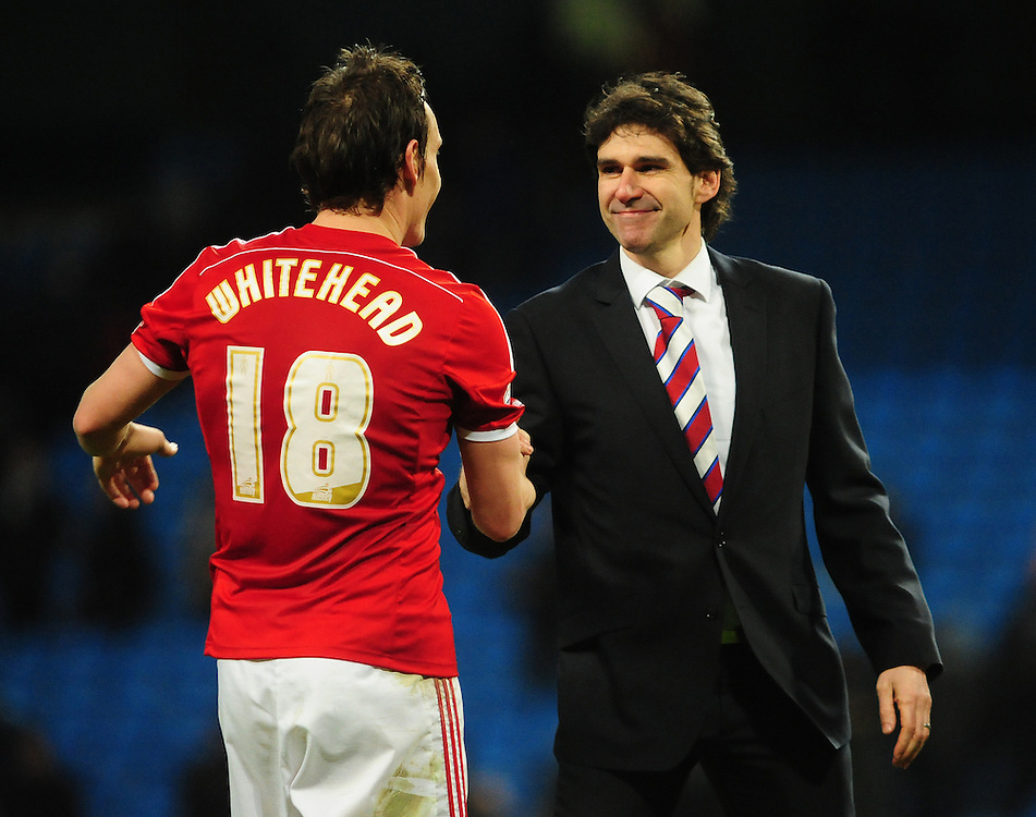 Middlesbrough's Dean Whitehead, left, and Middlesbrough manager Aitor Karanka celebrate the win over Manchester City in the FA Cup<br /> <br /> Photographer Chris Vaughan/CameraSport<br /> <br /> Football - The FA Cup Fourth Round - Manchester City v Middlesbrough - Saturday 24th January 2015 - Etihad Stadium - Manchester<br /> <br /> © CameraSport - 43 Linden Ave. Countesthorpe. Leicester. England. LE8 5PG - Tel: +44 (0) 116 277 4147 - admin@camerasport.com - www.camerasport.com