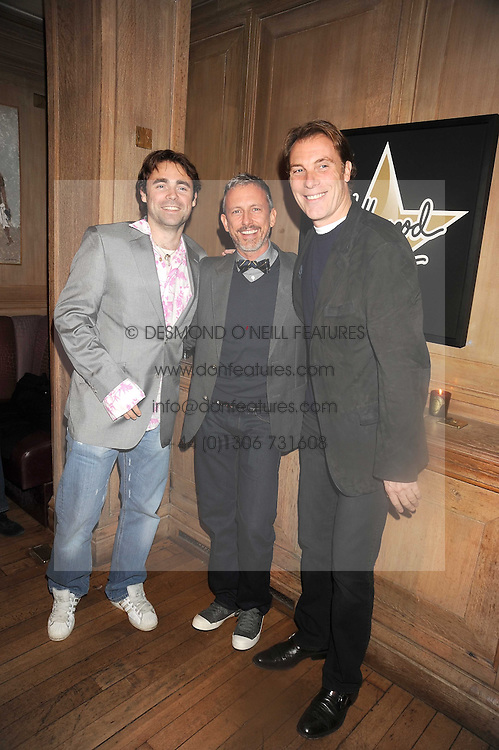 Left to right, JAMES ARCHER, PATRICK COX and DAMIAN ASPINALL at a party to celebrate the launch of Hollywood Domino - a brand new board game, held at Mosimann's 11b West Halkin Street, London on 7th November 2008.  The evening was in aid of Charlize Theron's Africa Outreach Project.