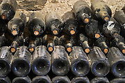 Piles of old bottles aging in the cellar, dusty old bottles Chateau Vannieres (Vannières) La Cadiere (Cadière) d'Azur Bandol Var Cote d'Azur France