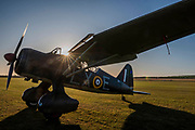 A Westland Lysander on the flight line as the sun rises - Duxford Battle of Britain Air Show at the Imperial War Museum. Also commemorating the 50th anniversary of the 1969 Battle of Britain film. It runs on Saturday 21 & Sunday 22 September 2019