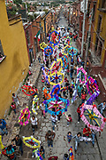 Colorful paper stars march in a fiesta procession through the city at the start of the week long fiesta of the patron saint Saint Michael September 22, 2017 in San Miguel de Allende, Mexico.