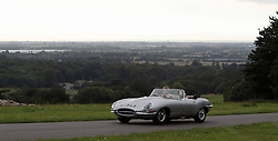 Jaguar E-type cars set off from Goodwood House in West Sussex on the E-type Round Britain Coastal Drive, a 3,600-mile coastal tour of Britain, in support of Prostate Cancer UK.