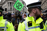 Extinction Rebellion disruption begins as the activists block 12 sites around Westminster amongst a high police presence on 7th October 2019 in London, England, United Kingdom. Extinction Rebellion is a climate change group started in 2018 and has gained a huge following of people committed to peaceful protests. These protests are highlighting that the government is not doing enough to avoid catastrophic climate change and to demand the government take radical action to save the planet.