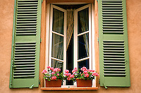 Green shutters and geranium filled window box, St. Tropez France