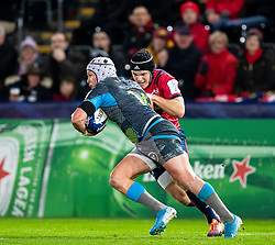 Hanno Dirksen of Ospreys under pressure from Tyler Bleyendaal of Munster <br /> <br /> Photographer Simon King/Replay Images<br /> <br /> European Rugby Champions Cup Round 1 - Ospreys v Munster - Saturday 16th November 2019 - Liberty Stadium - Swansea<br /> <br /> World Copyright © Replay Images . All rights reserved. info@replayimages.co.uk - http://replayimages.co.uk