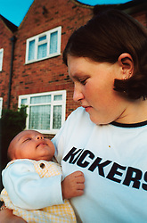 Teenage mother and baby living in temporary accomodation; Leeds UK
