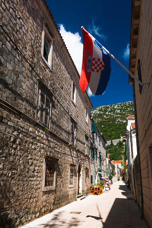 Narrow street and Croatian flag, Ston, Dalmatian Coast, Croatia