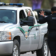 A member of the Florida Wildlife Commission waves to a Florida State Trooper as they search for suspect Markeith Loyd at the Tzadik Brookside Apartments on January 9 2017 in Orlando, Florida. Loyd shot an Orlando Police officer earlier in the day at a local Walmart, the officer has since died.  (Alex Menendez via AP)