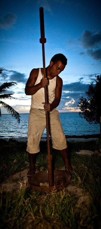Man with large Mortar and Pestle on the Beach, Fiji