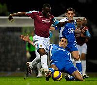 Photo: Alan Crowhurst.<br />West Ham United v Wigan Athletic. The Barclays Premiership. 06/12/2006. Nigel Reo-Coker (L) attacks for West Ham.