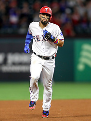 April 23, 2018 - Arlington, TX, U.S. - ARLINGTON, TX - APRIL 23: Texas Rangers catcher Robinson Chirinos rounds the bases after hitting a home run during the game between the Texas Rangers and the Oakland Athletics on April 23, 2018 at Globe Life Park in Arlington, Texas. (Photo by Steve Nurenberg/Icon Sportswire) (Credit Image: © Steve Nurenberg/Icon SMI via ZUMA Press)