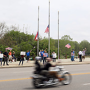 Attendees wave as motorcyclists pass by during the Memorial/Freedom Rally on the Conant Street Bridge in Maumee, Ohio, on Saturday, May 23, 2020. THE BLADE/KURT STEISS