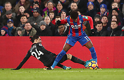 Arsenal's Hector Bellerin changeles Crystal Palace's Wilfried Zaha (right) during the Premier League match at Selhurst Park, London.