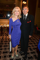 MICHAEL BLACK and JULIE ROGERS at the 90th birthday party for Nicholas Parsons held at the Hyatt Churchill Hotel, Portman Square, London on 8th October 2013.