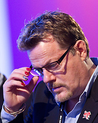 © Licensed to London News Pictures. 30/09/2012. Manchester, UK . Eddie Izzard with painted fingernails , in the audience in the conference hall . Labour Party Conference Day 1 at Manchester Central . Photo credit : Joel Goodman/LNP