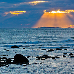 The sun shines down on the Isles of Shoals as seen from Rye Harbor State Park in Rye, New Hampshire.