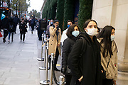 Shoppers outside Selfridges as Londoners await the imminent second coronavirus lockdown it's business as usual in the West End with large numbers of people, some wearing face masks and some not, coming to Oxford Street to go shopping on what will be the last weekend before a month-long total lockdown in the UK on 1st November 2020 in London, United Kingdom. The three tier system in the UK has not worked sufficiently, to suppress the virus, and there have have been calls by politicians for a 'circuit breaker' complete lockdown to be announced to help the growing spread of the Covid-19.