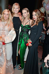 Left to right, ELLIE GOULDING, KARLIE KLOSS, TAYLOR SWIFT and CARA DELEVINGNE at 'The World's First Fabulous Fund Fair' in aid of the Naked Heart Foundation hosted by Natalia Vodianova and Karlie Kloss at The Roundhouse, Chalk Farm Road, London on 24th February 2015.