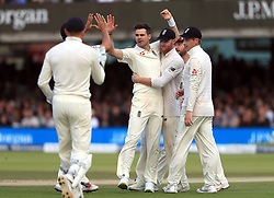 England's James Anderson (centre) celebrates taking the wicket of West Indies' Jermaine Blackwood during day three of the Third Investec Test match at Lord's, London.