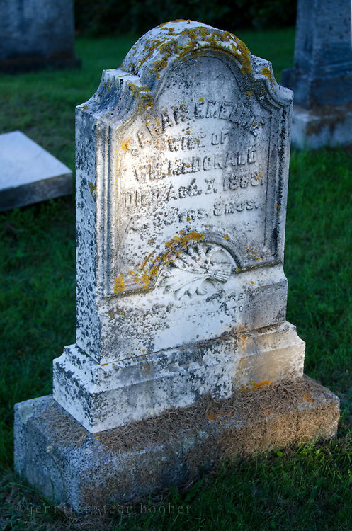 Old gravestone with elaborate profile, Sandy Point, Maine.