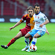 Galatasaray's Ayhan AKMAN (L) and Trabzonspor's Alan Carlos Gomes Da COSTA (R) during their Turkish superleague soccer derby match Galatasaray between Trabzonspor at the TT Arena in Istanbul Turkey on Sunday, 10 April 2011. Photo by TURKPIX