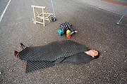 Sebastiaan Bowier ligt beschut tegen de wind te wachten. Het Human Power Team Delft en Amsterdam (HPT) traint op de RDW baan in Lelystad met de VeloX2 voor de recordpoging in september. Het HPT hoopt dan in Amerika meer dan 133 km/h te rijden over 200 meter.<br /> <br /> Sebastiaan Bowier shelters against the wind. Human Powered Team Delft and Amsterdam (HPT) is training at the RDW test track in Lelystad with the VeloX2 for the record attempt in september.
