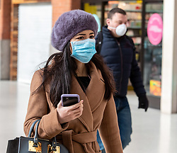 © Licensed to London News Pictures. 16/03/2020. London, UK. London workers in masks at a quiet Victoria Station this morning as Government ministers warn that over 70s will face self-isolation for weeks as the Coronavirus disease pandemic continues . Photo credit: Alex Lentati/LNP
