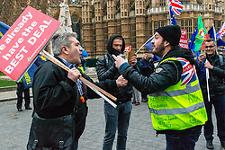 Pro-Brexit campaigner James Goddard, right, once again visits and attempts to disrupt Steve Bray's SODEM anti-Brexit protest the day after he was seen harassing former cabinet minister Anna Soubry. Westminster, London, December 20 2018.