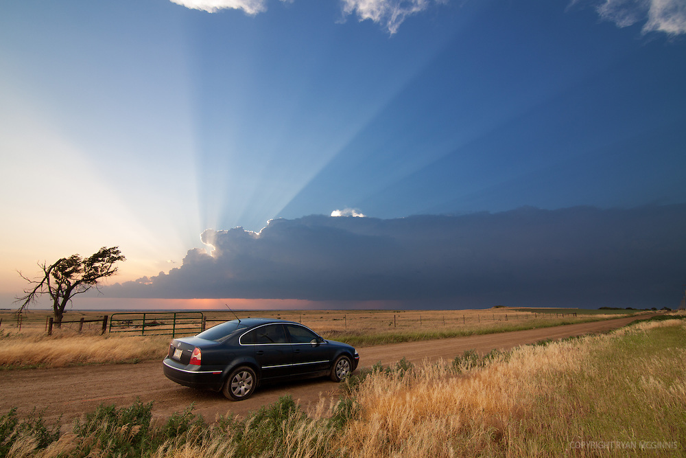 My chase vehicle highlighted against speculator rays on the horizon, May 27, 2012.