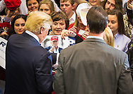 Woman handing Donald Trump a photo of Donald Trump to sign at a rally in Baton Rouge, Louisiana.