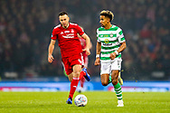 Scott Sinclair (#11) of Celtic dribbles the ball down the wing pursued by Andrew Considine (#4) of Aberdeen during the Betfred Cup Final between Celtic and Aberdeen at Celtic Park, Glasgow, Scotland on 2 December 2018.
