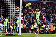 Aston Villa goalkeeper Brad Guzan makes a save from Fabian Delph of Manchester city. Barclays Premier league match, Aston Villa v Manchester city at Villa Park in Birmingham, Midlands  on Sunday 8th November 2015.<br /> pic by  Andrew Orchard, Andrew Orchard sports photography.