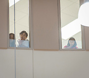 Students watch from the third floor during the dedication and ribbon cutting for the Mandarin Immersion Magnet School, October 24, 2016.