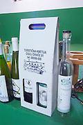 Various bottles of wine made at the winery on display on a shelf. Vita@I Vitaai Vitai Gangas Winery, Citluk, near Mostar. Federation Bosne i Hercegovine. Bosnia Herzegovina, Europe.
