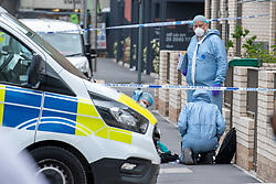 © Licensed to London News Pictures. 11/06/2021. London, UK. Forensic investigators at the scene of a fatal stabbing in Hayes, Metropolitan Police were called at 08:34BST to a report of a fight on Blyth Road in Hayes. Emergency services, including London Ambulance Service and London's Air Ambulance, attended the location and found a 15-year-old boy suffering from multiple stab wounds. The teenager died at the scene. Photo credit: Peter Manning/LNP