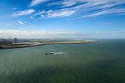 Nederland, Zuid-Holland, Rotterdam, 23-10-2013; coast vaart naar de ingang van de haven van Rotterdam, de Nieuwe Waterweg. In de achtergrond de Eerste Maasvlakte en de Tweede Maasvlakte MV2 (rechts).<br /> A ship enters the Port of Rotterdam via the Nieuwe Waterweg. In the back the second Maasvlakte, the expansion of the Port of Rotterdam, the second Maasvlakte (r)<br /> luchtfoto (toeslag op standard tarieven);<br /> aerial photo (additional fee required);<br /> copyright foto/photo Siebe Swart