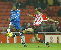 Photo. Andrew Unwin<br /> Sunderland v Wigan Athletic, Nationwide League Division One, Stadium of Light, Sunderland 02/12/2003.<br /> Sunderland's Joachim Bjorklund (r) looks to tackle Wigan's Nathan Ellington (l).