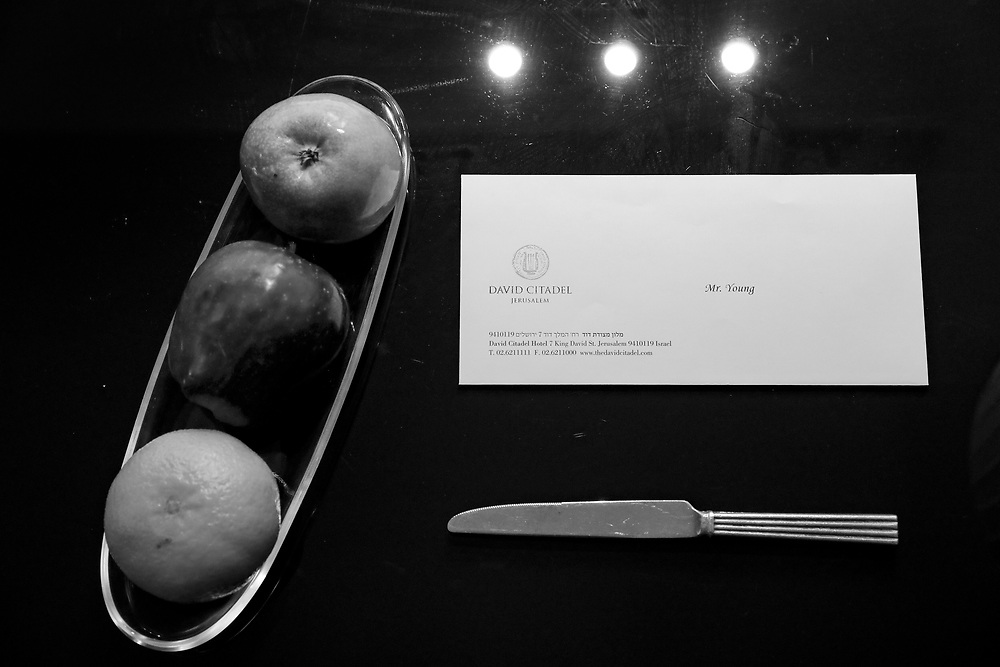 A fruit bowl and welcoming letter are seen inside a hhotel room in Jerusalem, Israel.