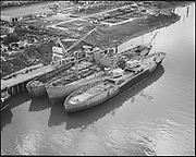 """Ackroyd 14339-4 """"Schnitzer Industires. Aerials of barge with whirly cranes. December 20, 1966"""""""