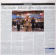 Page 1 photos and video for The Wall Street Journal profiling militant Red Shirt Leader Major General Khattiya Sawasdipol, also known as Seh Daeng, at the Red Shirt front line in Lumpini Park, Bangkok, Thailand.  Seh Daeng was shot by a sniper in the same area 10 days later.
