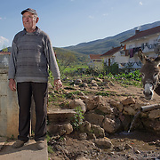 Dimitre Stavre (75) with his donkey in Liqenes, Albania