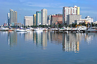 Manila Bay is a natural harbor which serves the Port of Manila in the Philippines. The bay is considered to be one of the best natural harbors in Southeast Asia and one of the finest in the world. It also serves a focus for recreation for Metro Manila and is a popular destination for walks and for viewing the sunset.