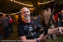Michael Lichter working the Friday night opening of the Handbuilt Motorcycle Show. Austin, TX. April 10, 2015.  Photography ©2015 Michael Lichter.