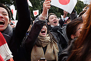 New Year celebrations at the Tokyo Imperial Palace. Crowds gather as the Emperor makes a public appearance. Tokyo, Japan