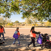 101213  Adron Gardner/Independent<br /> <br /> Domestic Violence Awareness walkers begin their journey way from the Gallup Police Department on the way to the McKinley County Courthouse Saturday.