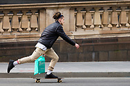 A skateboarder is seen skating by Parliament House during COVID-19. A further 238 Coronavirus cases have been discovered overnight, bringing Victoria's active cases to over 2000, speculation is rising that almost all of Victoria's current cases stem from the Andrews Government botched hotel quarantine scheme as well as the Black Lives Matter protest.  Premier Daniel Andrews warns that Victoria may go to Stage 4 lockdown if these high numbers continue. (Photo be Dave Hewison/ Speed Media)
