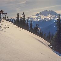 Skiers enjoy the slopes at Crystal Mountain ski area, Washington. Mount Rainier bkg.