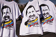 T-Shirts for sale during the funeral of Hugo Chávez in Caracas, 8th March 2013. During Hugo Chávez funeral many people and stand sold miscellaneous articles that perpetuate Chávez presence. Everything from T-shirts, badges, earrings, baseball caps, sun glasses seemed suitable to have the President's image. The cult of Chávez is now more alive than ever.