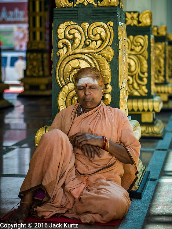 17 NOVEMBER 2016 - GEORGE TOWN, PENANG, MALAYSIA:  A woman meditates in the Sri Mahamariamman Hindu Temple in George Town, Penang, Malaysia. George Town is a UNESCO World Heritage city and wrestles with maintaining its traditional lifestyle and mass tourism.       PHOTO BY JACK KURTZ